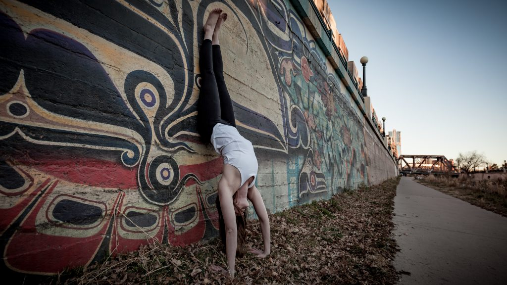 Yoga handstand against a wall